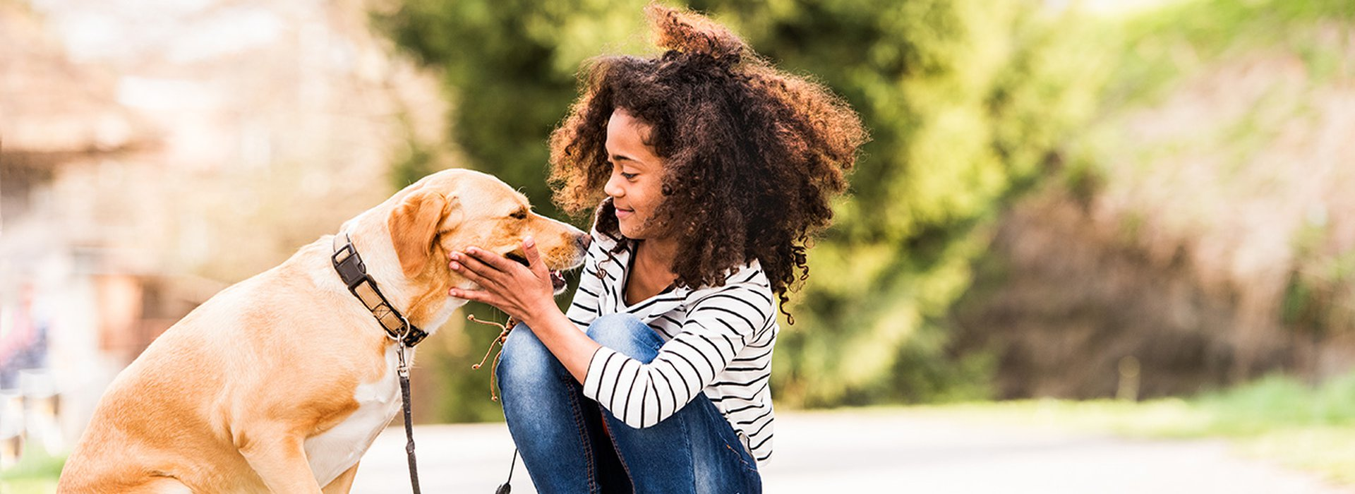 African american girl outdoors on skateboard with her dog